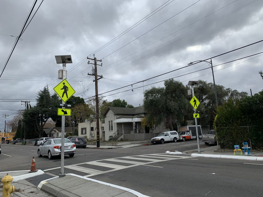 Bulbouts are an extension of the sidewalk. It will help shorten the crossing distance and increase pedestrian visibility at the intersection. Photo was taken at intersections Edwards Ave. & Vine St., San Jose.