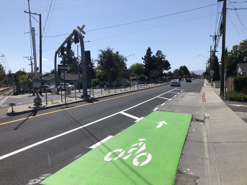 Shows the reader what a buffered bike lane looks like